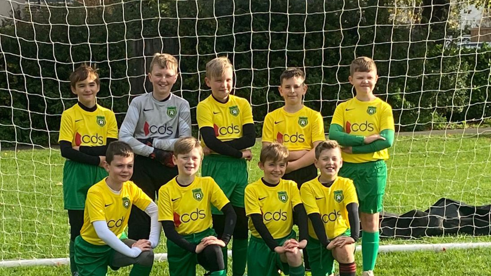 Young footballers proudly display their new CDS sponsored kit
